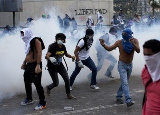 Venezuela's police and National Guard have used tear gas to break up a student demonstration in Caracas
