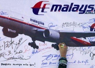 """A Chinese plane hunting for the missing Malaysia Airlines plane has spotted """"suspicious"""" objects"""