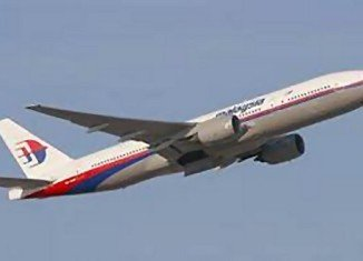 An Australian plane has spotted two objects in the hunt for the missing Malaysia Airlines jet