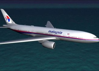 Australia is investigating two objects seen on satellite images that could potentially be linked to the missing Malaysia Airlines plane