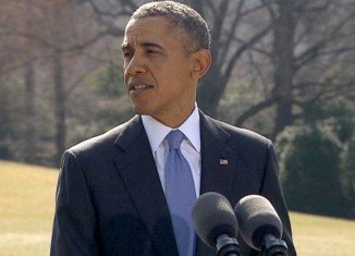 Barack Obama has announced more sanctions on Russian officials and Bank Rossiya over the annexation of Crimea