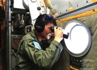 Four planes were trying to check whether two objects seen on satellite images were debris from flight MH370