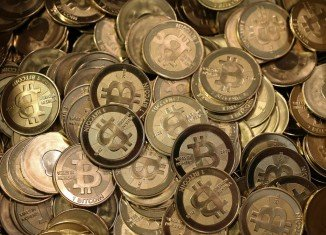 Japan's government says Bitcoin is not a currency but some transactions using the virtual unit should be taxed