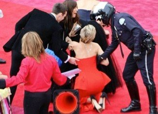 Jennifer Lawrence took a tumble as she made her way down the Oscar red carpet