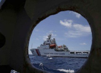 Journalists on board of the Philippine ship have witnessed Chinese coast guard vessels trying to block access to a disputed shoal in the South China Sea