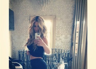 Kim Zolciak showed off her post-baby belly after giving birth to twins just five months ago