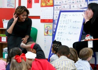 Michelle Obama is in China for a week-long visit that includes stops in Beijing and Chengdu