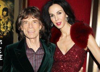 "Mick Jagger is ""struggling"" to understand the death of his girlfriend L'Wren Scott"