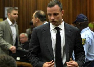 Oscar Pistorius was praying over the body of his girlfriend Reeva Steenkamp as she lay dying