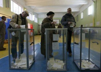 Some 95.5 percent of voters in Crimea have supported joining Russia in a disputed referendum