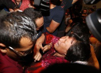 The missing jet relatives were prevented from entering the media centre in Kuala Lumpur, before being bundled away
