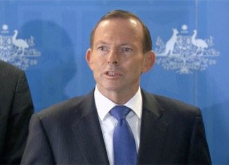 Tony Abbott told reporters near Perth that the hunt for flight MH370 was still being stepped up