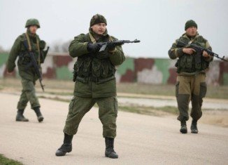 Troops wearing Russian uniform without insignia have blockaded military bases since taking control of Crimea last week