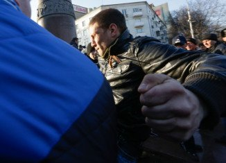 Two people have been killed in clashes between pro-Ukrainian and pro-Russian activists in Ukraine's eastern city of Kharkiv
