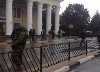 Unidentified soldiers are guarding key buildings in Crimea