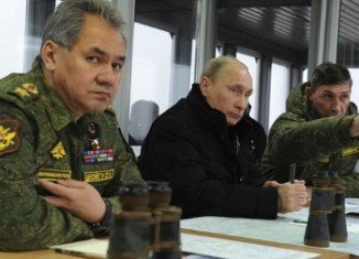 Vladimir Putin says there is no need yet to send Russian troops into Ukraine, but he has not ruled out doing so