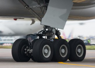 A 16-year-old boy has survived an extraordinary journey hidden in the wheel well of a five-hour flight from California to Hawaii