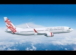 A Virgin Australia passenger who caused a hijack scare on a flight from Australia to Indonesia has been arrested at Bali airport