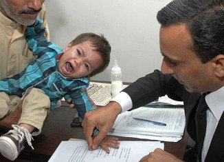 Baby Muhammad Musa Khan was one of more than 30 people charged with attempting to kill police officers during a confrontation over electricity and gas supplies in Lahore