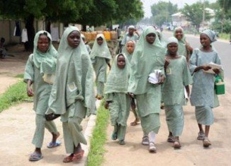Boko Haram gunmen abducted around 100 schoolgirls in an attack on a school in north-east Nigeria