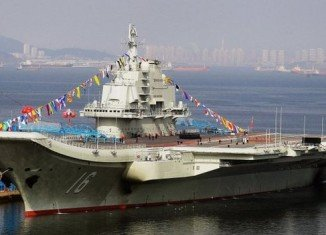 Chuck Hagel has toured the Liaoning - China's first aircraft carrier - at the beginning of a three-day visit to the country