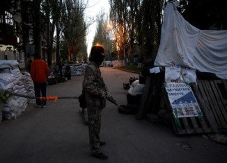 Forces in Sloviansk are holding eight European military observers and several Ukrainian army personnel
