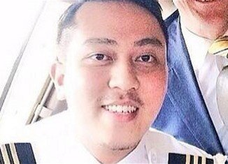 Malaysia Airlines flight MH370 co-pilot Fariq Abdul Hamid tried to make a call with his cellphone after the plane was diverted from its scheduled route