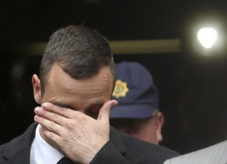 "Oscar Pistorius has told his murder trial in Pretoria he was ""heartbroken"" when he saw the body of his girlfriend Reeva Steenkamp"