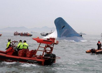 South Korean emergency services are continuing to search overnight for almost 300 people missing after Sewol ferry carrying 462 people sank off Jindo Island