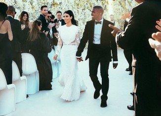 Kim Kardashian has changed her name to Kim Kardashian West after marrying Kanye West in Florence