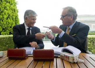Last July, Omnicom's chief executive John Wren was pictured signing the deal on the roof of the Paris headquarters of Publicis with its CEO Maurice Levy