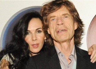 Mick Jagger sang a version of Bob Dylan's Just Like a Woman at a memorial service for his partner L'Wren Scott