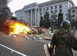 PM Arseniy Yatsenyuk has blamed Ukraine's security services for failing to stop Odessa violence that left more than 40 people dead