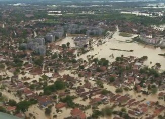 Serbia and Bosnia call for international help to rescue people from flooded areas after the worst flooding since modern records began