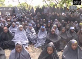 The US is flying manned surveillance missions over Nigeria to try to find more than 200 schoolgirls kidnapped by the militant Islamist group Boko Haram
