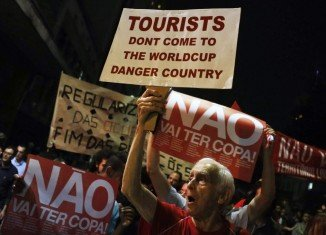 Thousands of protesters in Sao Paulo and Rio de Janeiro marched against the cost of hosting the football World Cup in Brazil