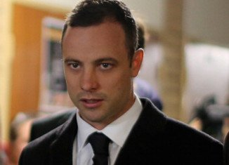 Two of Oscar Pistorius' closest neighbors said on Tuesday they heard a man crying loudly on the night of the shooting