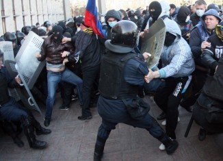 Violence between pro-Russian separatists and Ukrainian forces has left dozens dead in the east and south