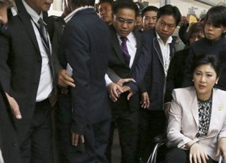 Yingluck Shinawatra is one of more than 100 political figures summoned by the army