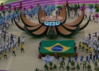 A cast of 660 dancers paid tribute to Brazil's nature, people and football with a show around a living ball on the Arena de Sao Paulo pitch