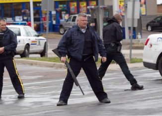 Canadian police arrested Justin Bourque suspected of killing three officers and wounding two others in Moncton