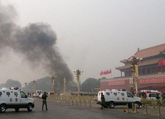 Police officers have killed 13 assailants in an attack on a police station in China's restive western province of Xinjiang