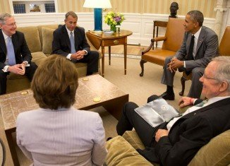 President Barack Obama has told Congressional leaders he does not need lawmakers' approval for any action in Iraq