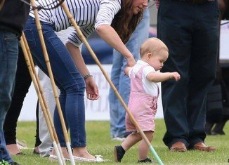 Prince George's tentative steps were captured on Sunday as Princes William and Harry lined up on opposing sides in the Jerudong Trophy at Cirencester Park Polo Club