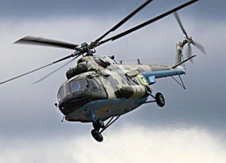 Ukraine's Mi-8 helicopter, used for transporting military cargo, was hit by a rocket shortly after take-off outside the rebel-held city of Sloviansk