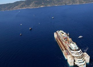 Costa Concordia is about to arrive in the port of Genoa for scrapping after a two-year salvage operation