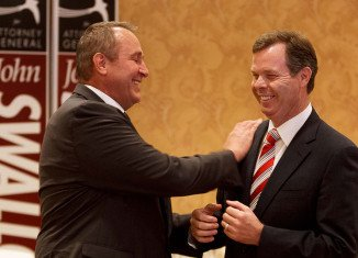 Mark Shurtleff and John Swallow are accused of accepting cash or campaign contributions from people facing potential scrutiny by the attorney general's office