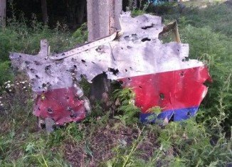 The downed Malaysia Airlines plane in eastern Ukraine suffered an explosive loss of pressure after it was punctured by shrapnel from a missile