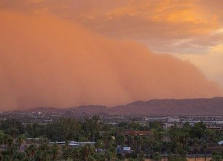 The huge sandstorm covered the Greater Phoenix, knocking out power to 12,000 residents, and delaying flights