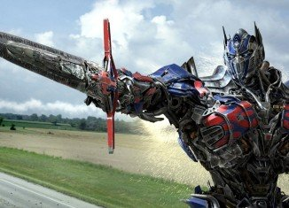 Transformers: Age of Extinction has topped the North American box office on an unusually quiet 4th of July weekend